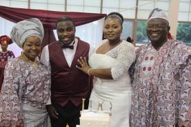 Bride and Groom with bride's parents, Alhaji and Alhaja Sokoya