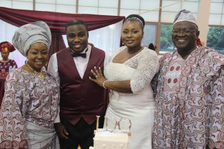 Bride and Groom with bride's parents, Alhaji and Alhaja Sokoya
