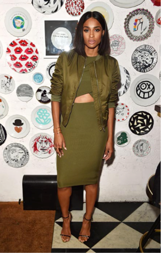 Kylie Jenner remixes an olive green strapless dress with white heels.